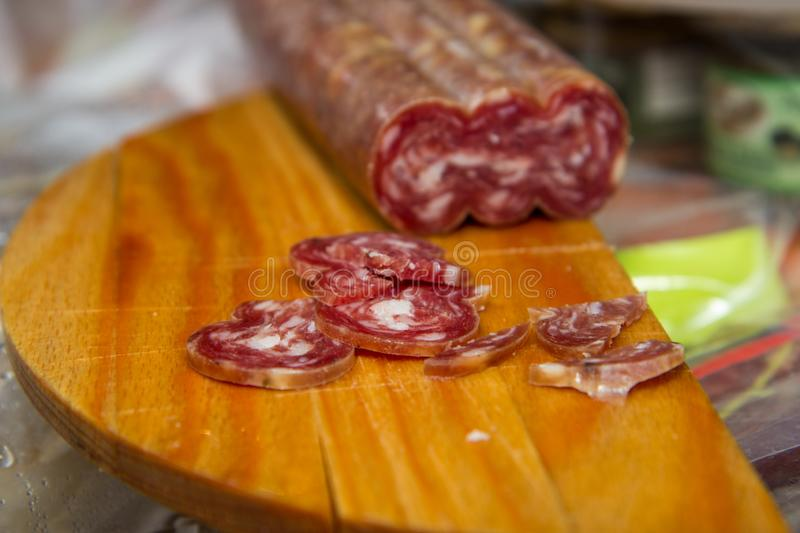 Salami is a type of cured sausage consisting of fermented and air-dried meat, typically beef or typical products of Emilia Romagna. Salami is a type of cured stock photo