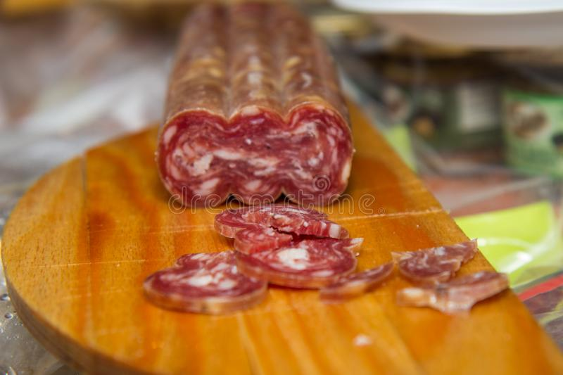 Salami is a type of cured sausage consisting of fermented and air-dried meat, typically beef or typical products of Emilia Romagna. Salami is a type of cured stock photos