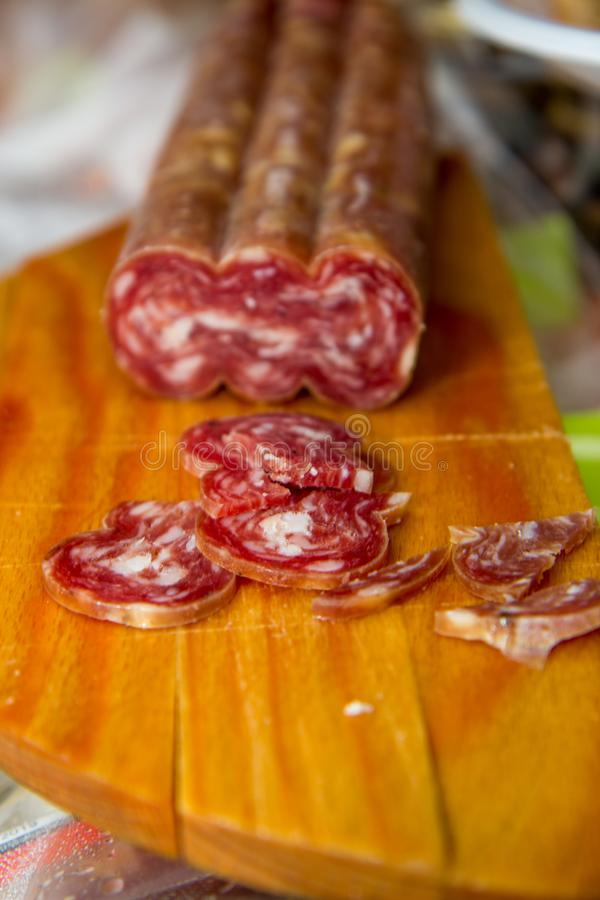 Salami is a type of cured sausage consisting of fermented and air-dried meat, typically beef or typical products of Emilia Romagna. Salami is a type of cured stock image