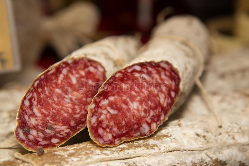 Salami is a type of cured sausage consisting of fermented and air-dried meat, typically beef or typical products of Emilia Romagna. Salami is a type of cured stock photography