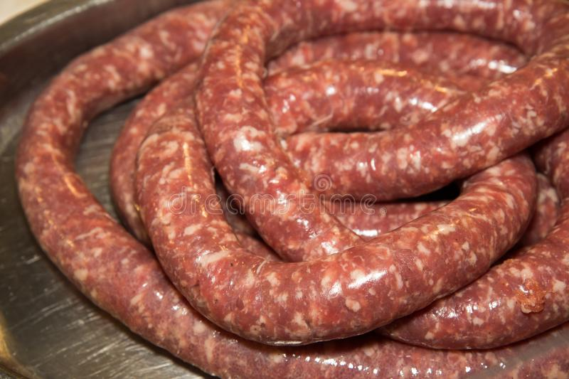 Salami is a type of cured sausage consisting of fermented and air-dried meat, typically beef or typical products of Emilia Romagna. Salami is a type of cured royalty free stock image