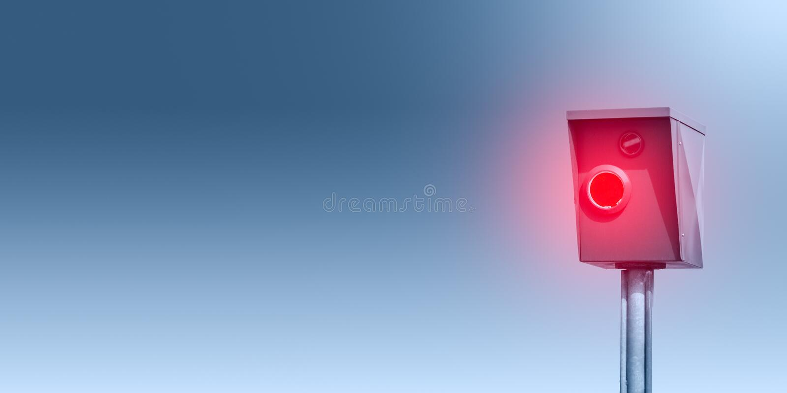 A typical radar trap, speed trap, speed camera in front of blue background - Banner stock photos