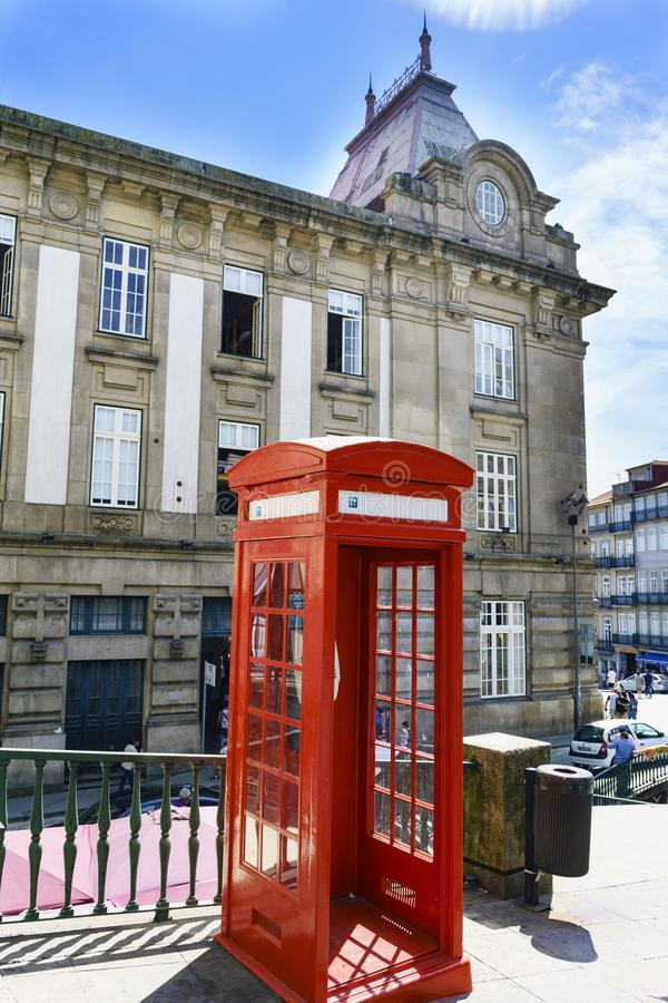 Typical red telephone booth located in the square called Almeida Garret in the center of town. Porto, Portugal. August 12, 2017: Typical red telephone booth royalty free stock image
