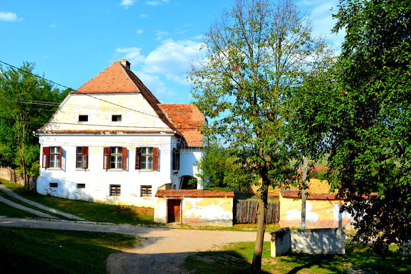 Typical rural landscape and peasant houses in the village TicuÅŸu Vechi, Deutsch-Tekes royalty free stock image