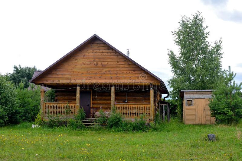 Typical Russian cottage, dacha in Russian. Dacha is a house for seasonal residence, located in the countryside. Designed for family recreation and the royalty free stock photo