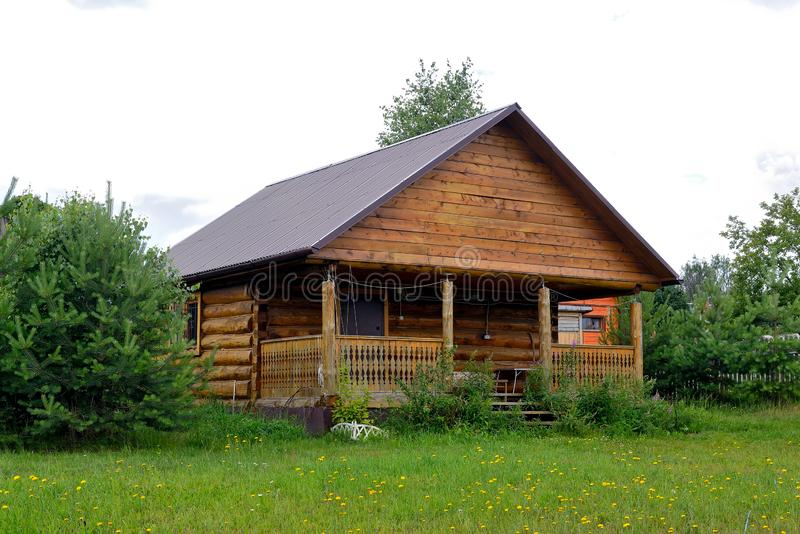 Typical Russian cottage, dacha in Russian. Dacha is a house for seasonal residence, located in the countryside. Designed for family recreation and the royalty free stock photos