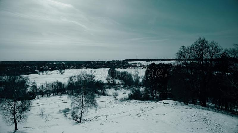Typical Russian winter scenery involving distant town, pan shot stock photography
