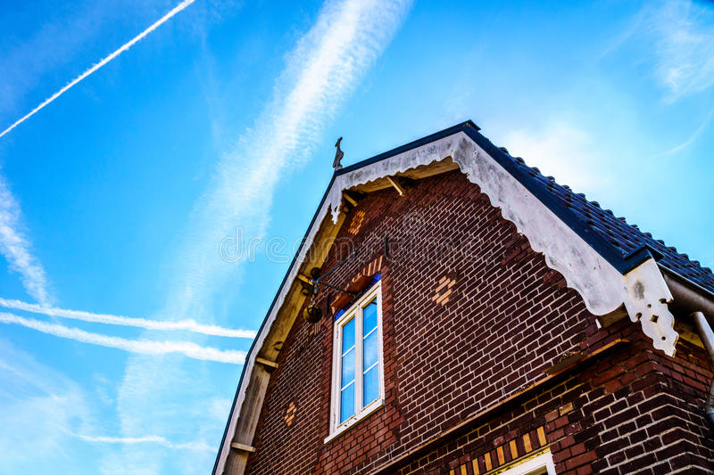 Typical Saddle Roof of a Brick House in a Historic Fishing Village. Typical Saddle Roof of a Brick House in the Historic Fishing Village of Bunschoten-Spakenburg stock image