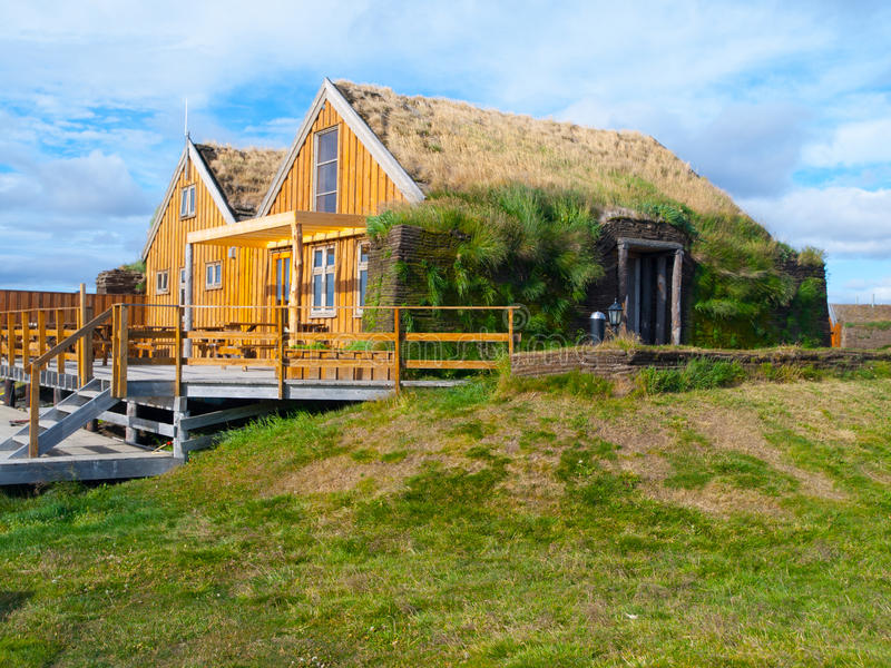 Typical scandinavian house with grass roof stock images