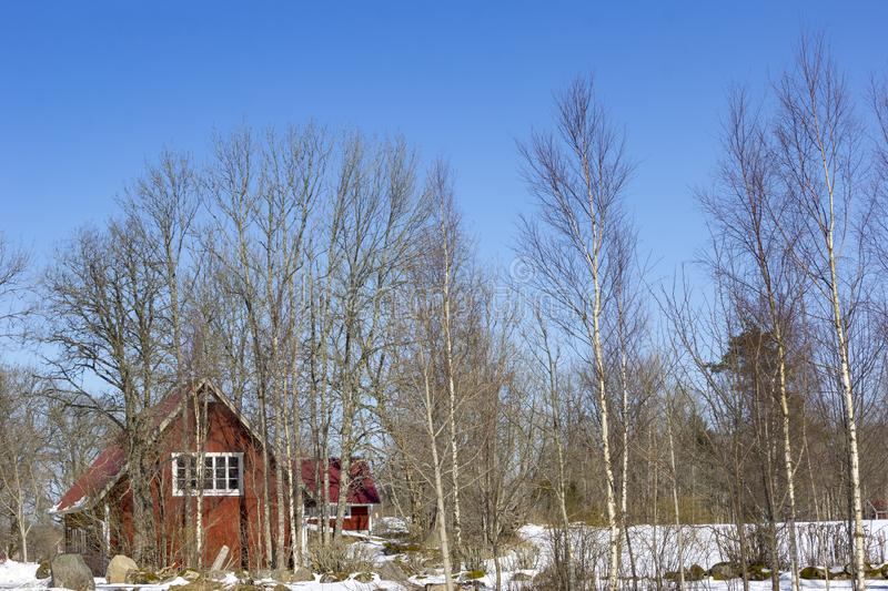 A typical Scandinavian house, winter landscape in Sweden stock photography