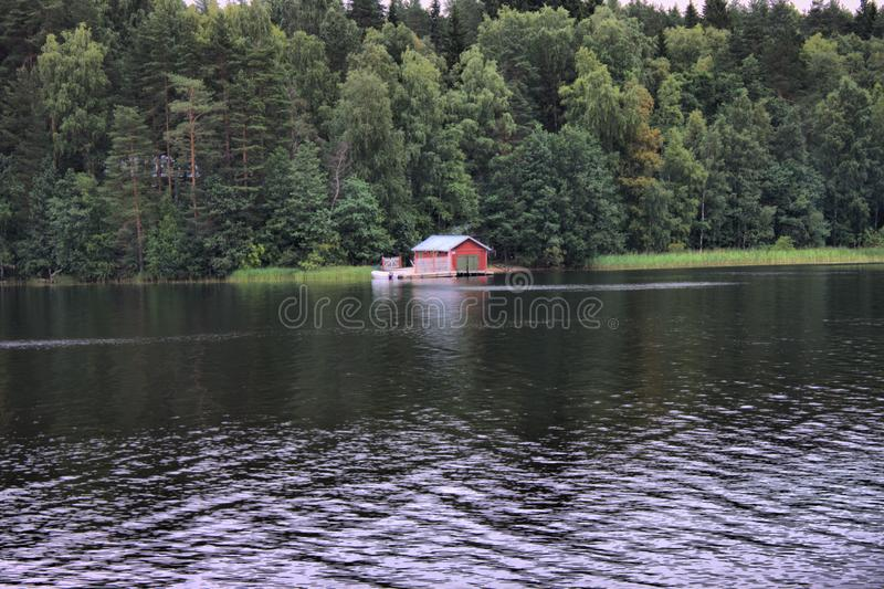 Typical scandinavian red wooden house stock photos