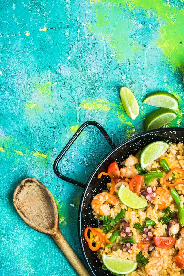 Typical seafood spanish paella in enamel pan stock photos