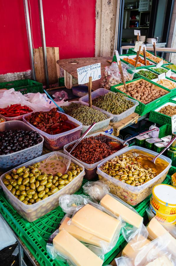 Typical Sicilian products for sale at the market. Typical Sicilian products such as olives, capers, walnuts, dried tomatoes and cheeses for sale at the historic stock image