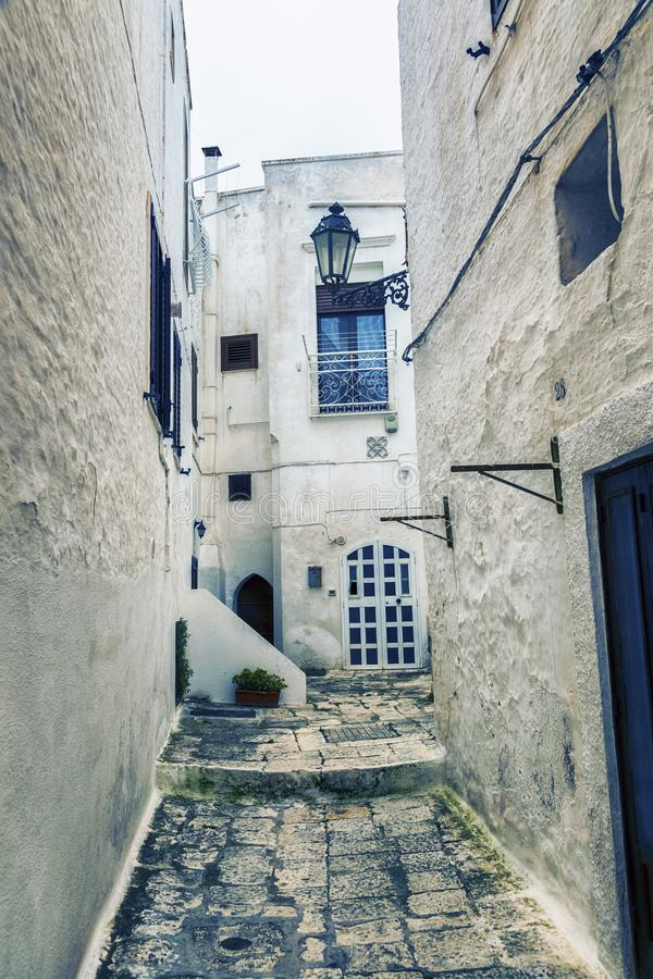 Small street in Ostuni  - ancient white town in Italy stock images