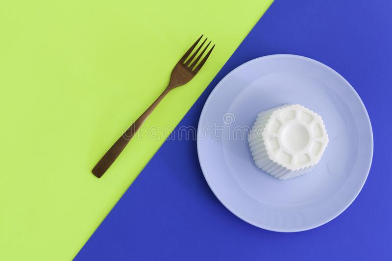Typical Spanish fresh cheese in a blue plate and fork stock photography