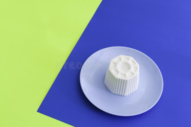 Typical Spanish fresh cheese in a blue plate royalty free stock photography