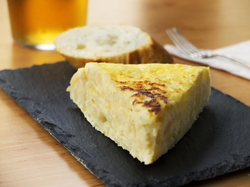 Typical spanish pincho de tortilla de patatas stock image