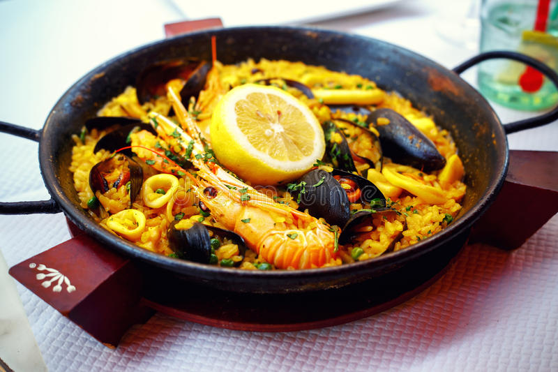 Typical spanish seafood paella in pan royalty free stock photography