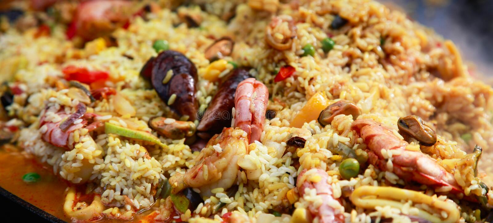 Typical spanish seafood paella in traditional pan royalty free stock photo