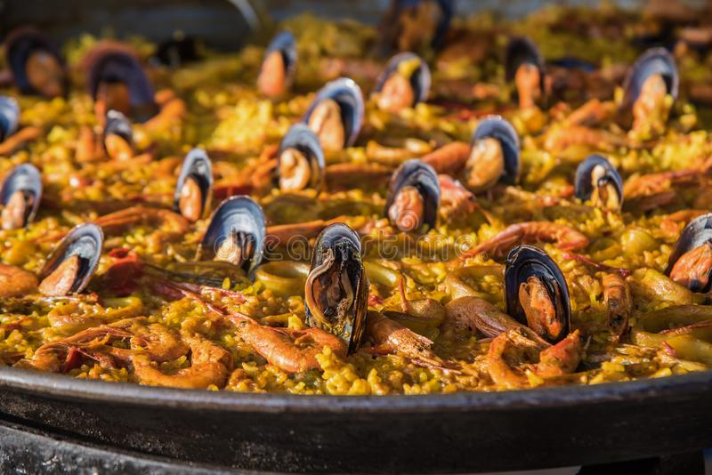 Typical spanish seafood paella in traditional pan close view. Selective focus4 royalty free stock images