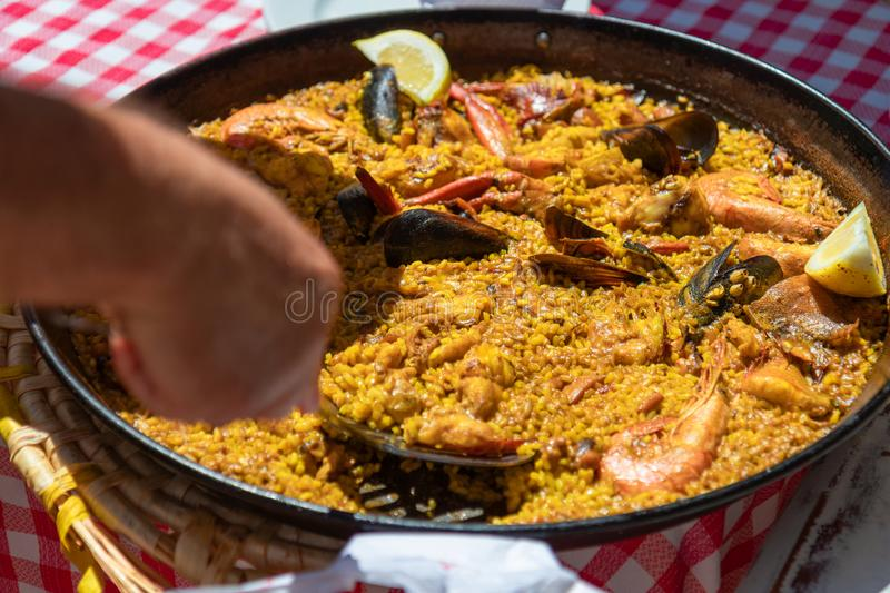 Typical seafood paella in the traditional fry pan Ibiza, Spain stock images