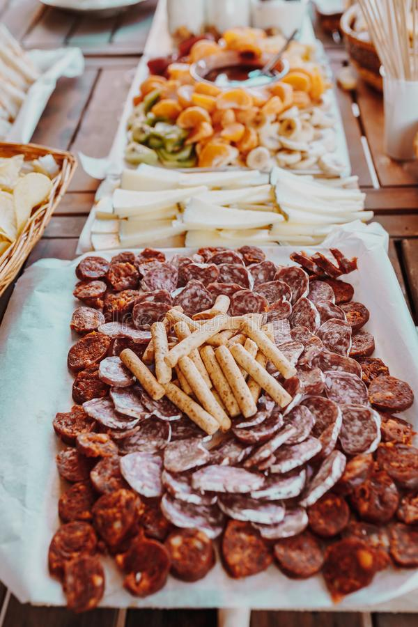 Typical spanish tapas concept. Concept include variety slices ham, chorizo, salami, cheese, chips, bread, sandwiches, donuts, royalty free stock image