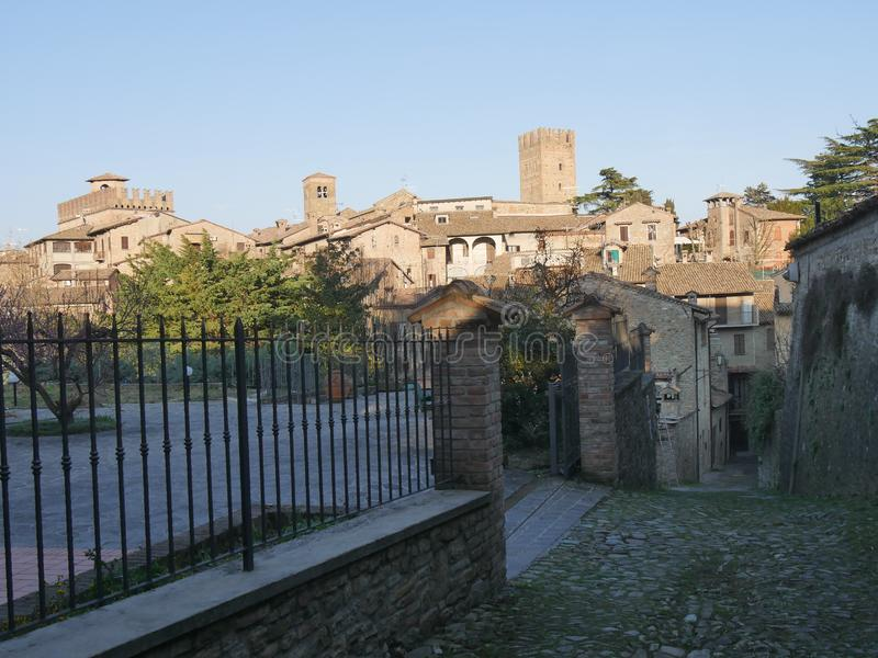 Typical street in Castell`Arquato. They were built in Medieval age with Arda river stones royalty free stock images