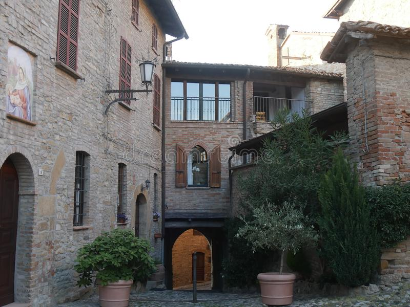 Typical street in Castell`Arquato. They were built in Medieval age with Arda river stones stock photo