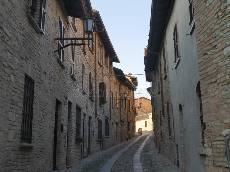 Typical street in Castell`Arquato. They were built in Medieval age with Arda river stones royalty free stock photos