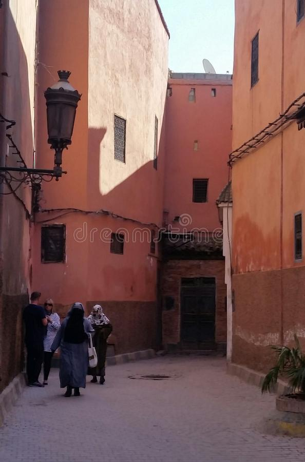 Typical street in the medina old town of the pink city of Marrakesh, Morocco. stock images