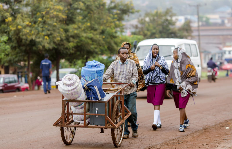 Typical street scene in Arusha, Tanzania. AFRICA, TANZANIA, MAY, 09, 2016 - Typical street scene in Arusha. Mostly a wheelbarrow is the only means of royalty free stock image