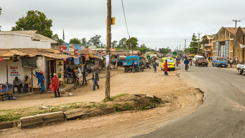 Typical street scene in Arusha, Tanzania. ARUSHA, TANZANIA - OCTOBER 21, 2014 : Typical street scene in Arusha. Arusha is located below Mount Meru in the eastern royalty free stock image