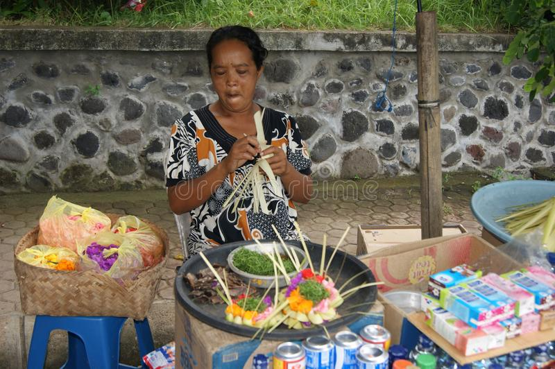Typical balinese street scene - holy gifts seller royalty free stock photography