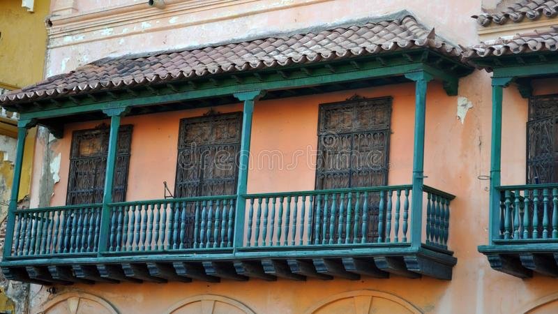 Typical street scene in Cartagena, Colombia of a street with old historic colonial houses. Alley america architecture balconies balcony blue building caribbean royalty free stock photo
