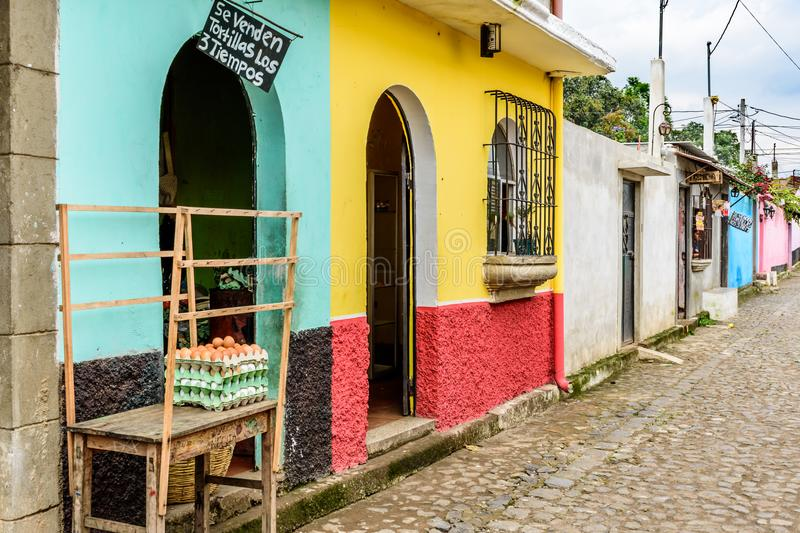 Typical street scene of houses & stores in Guatemalan village stock images