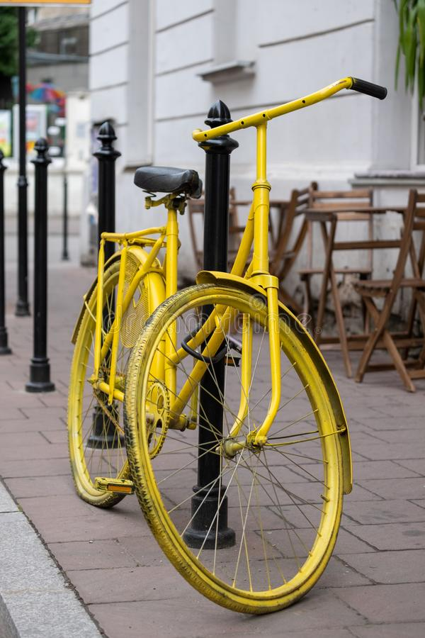 Yellow bicycle parked outside a coffee shop near Plac Nowy New Square in Kazimierz, the historic Jewish quarter of Krakow. Typical Street scene in Krakow stock photos