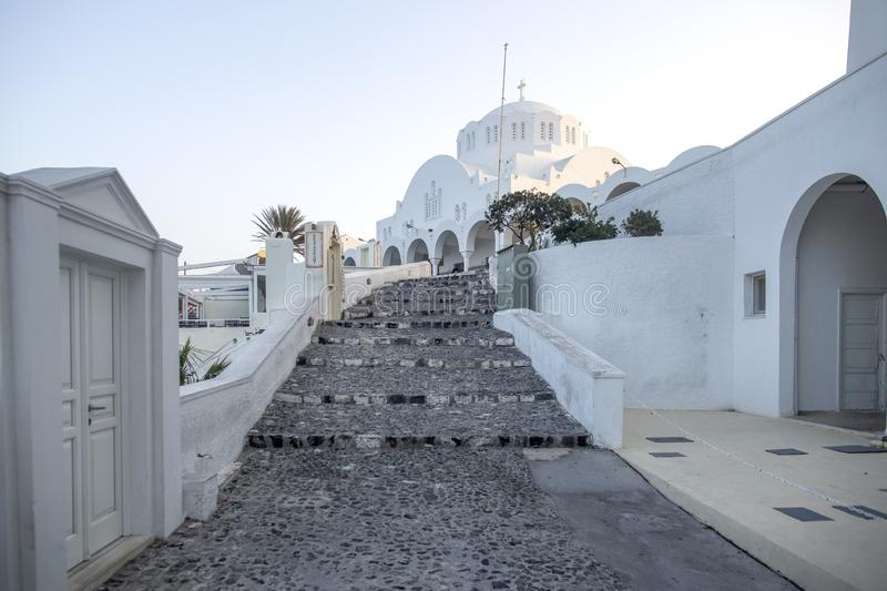 Typical street in Thira on the island of Santorini, Greece. Travel, Cruises, Architecture, Landscapes. Greek street and Orthodox stock photos