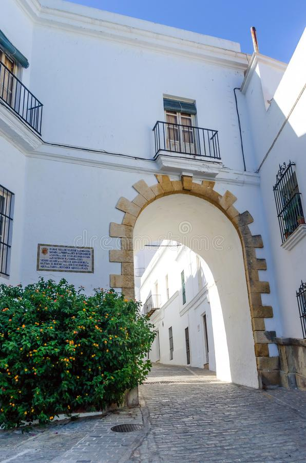 Vjer de la Frontera typical arch in the street. Typical street in Vejer de la Frontera, pueblo blanco, Cadiz, Andalusia, Spain stock images