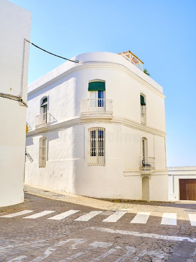 Vejer de la Frontera downtown. Cadiz province, Andalusia, Spain. A typical street of whitewashed walls of Vejer de la Frontera downtown. View from Padre Caro stock photos