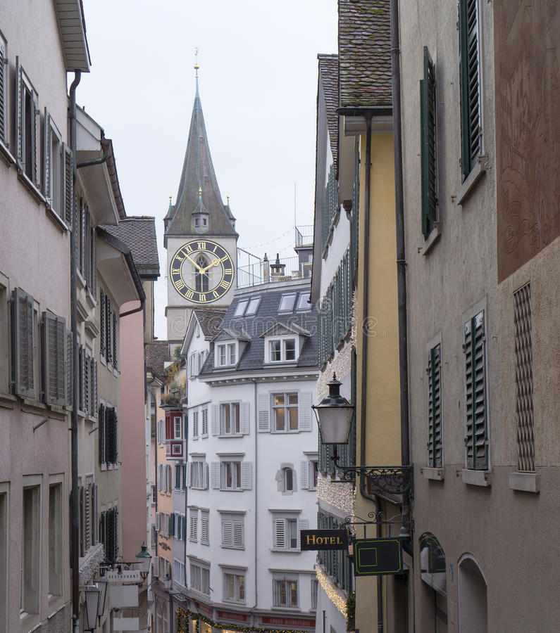 Typical swiss buildings with St. Peter church from Zurich stock photos