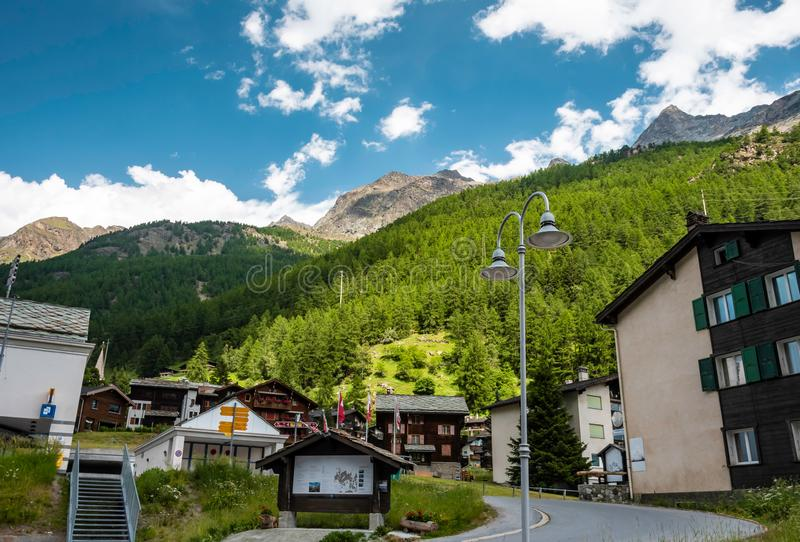 Typical Swiss Wooden chalets in canton of Valais, Switzerland in summer. Typical Swiss Wooden chalets in canton of Valais, Switzerland in summer royalty free stock images