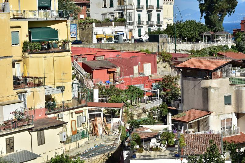 Coastal Mediterranean terrace houses. Typical terrace houses with mostly flat roofs on steep cliffs of Mediterranean coast of Naples in Italy royalty free stock photography