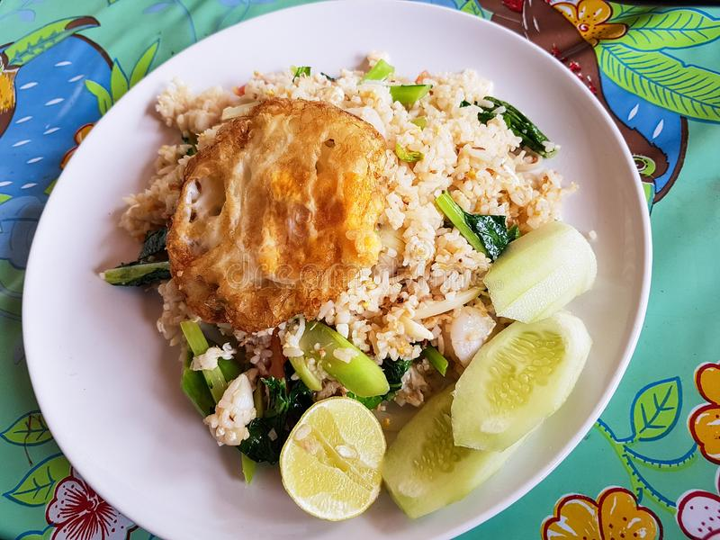 A tasty thai dish with rice. A typical thai dish with seafood, eggs, rice and vegetables served in a plate royalty free stock photos