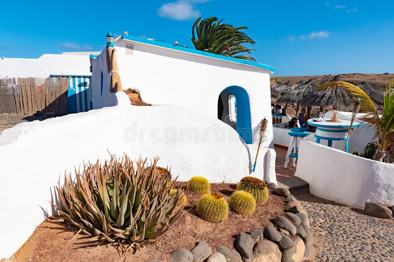 Typical tiny Canarian house with cactus garden on Papagayo beach on the island of Lanzarote, Canary Islands, Spain stock images