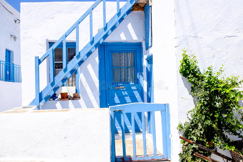Typical traditional doors and windows in Greek white and blue st royalty free stock photos