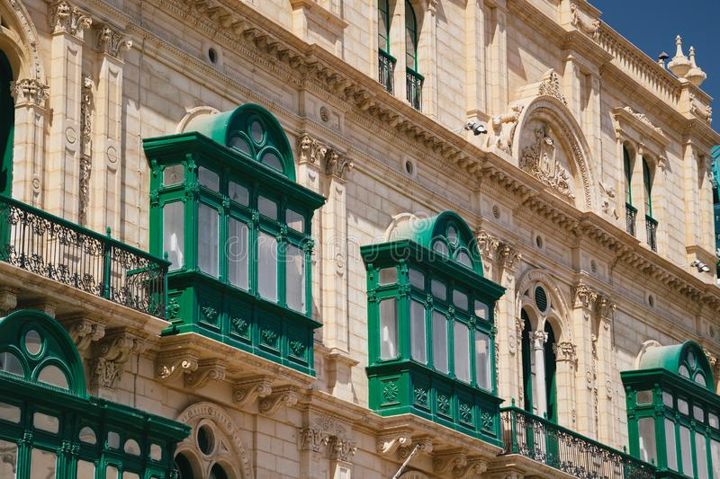 Typical traditional wooden green maltese balconies in the centre of Valletta, capital of Malta. Popular touristic destination and royalty free stock images