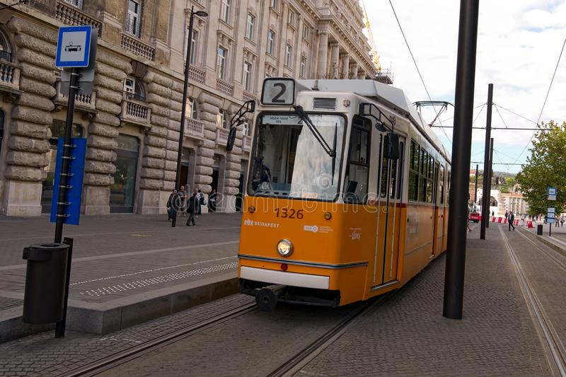 Typical tram stop in Budapest. Yellow vintage tram. Famous lane 2. royalty free stock image
