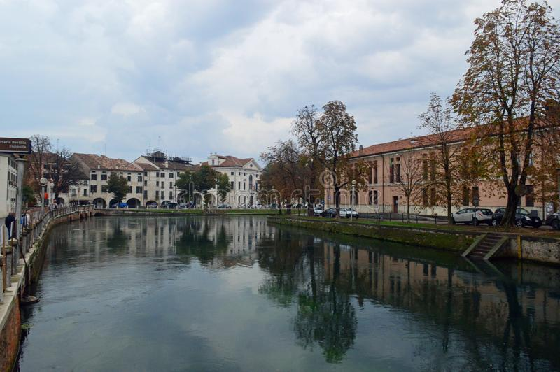 Typical treviso architecture by the river on a cloudy day. Typical colourful italianate venetian style architecture on a cloudy day lining the River Sile Treviso royalty free stock photo