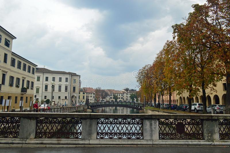 Typical treviso architecture by the river on a cloudy day. Typical colourful italianate venetian style architecture on a cloudy day lining the River Sile Treviso stock photography