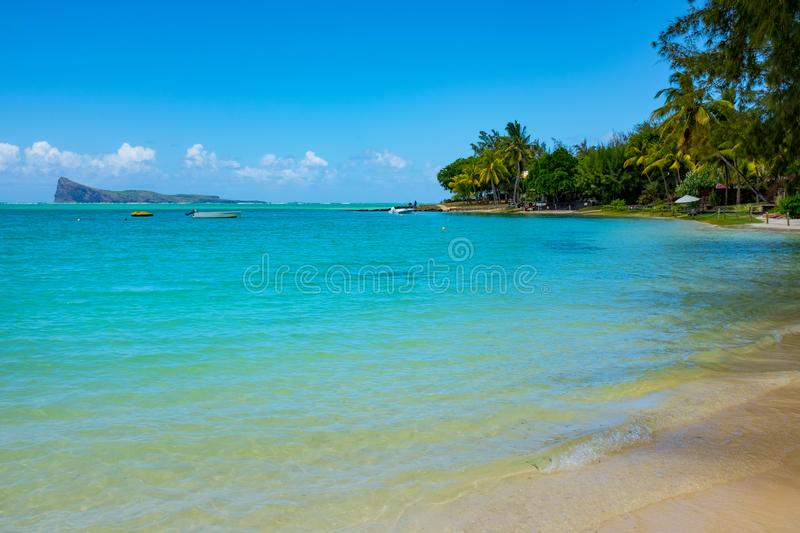 Typical tropical beach Mauritius. Relaxing on remote Paradise beach,typical tropical beach at Mauritius island stock photos
